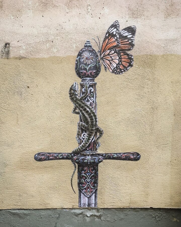 11-Lizard-on-a-Sword-and-Butterfly-Steeven-Salvat-www-designstack-co