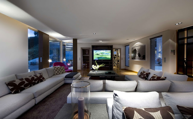 Modern living room as seen at night