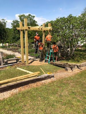 Jacob and volunteers work on his Eagle Scout project