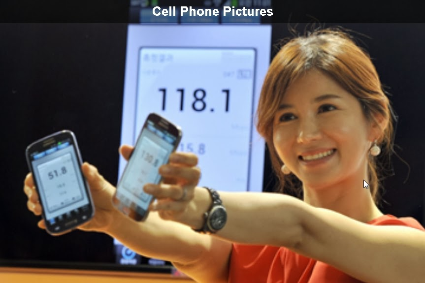 A South Korean model displays wireless data speeds on two Galaxy S4 smartphones via SK Telecom's new mobile network in Seoul. See more telecom pictures. See more cell phone pictures.