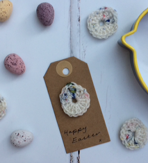 Crochet egg topper on a gift tag