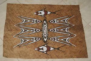 khombow ukiran kulit kayu khas sentani papua carvings