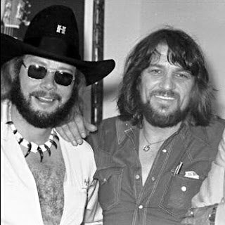 Hank Williams Jr standing with Waylon Jennings