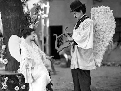 """Чарли Чаплин и Лита Грей в фильме """"Малыш"""" (The Kid) (1921)"""