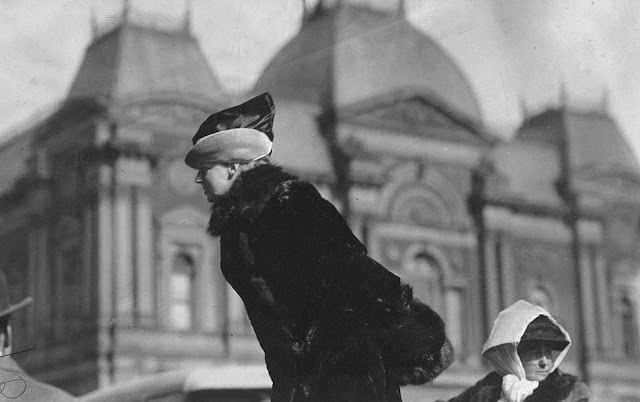 At an open air meeting in Washington, District of Columbia, in March of 1913, calling upon Congress to pass the national woman suffrage amendment. This photograph shows Mrs. John Rogers, sister-in-law of former Secretary of War, and a member of the Advisory Council of the Congressional Union for Women Suffrage, speaking in front of old Corcoran Art Gallery.