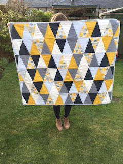 http://kathrynsbusytown.blogspot.co.uk/2016/02/triangle-quilt.html