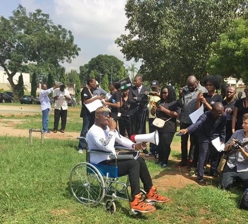 Charly Boy In Wheelchair As He Joins Other In Protest To Aso Rock Over Killings (Photos)