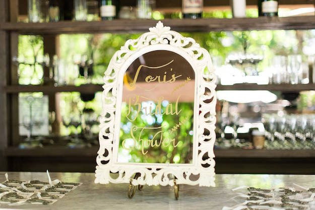 rustic italian olive oil branch bridal shower wedding outdoor mirror calligraphy escort card table