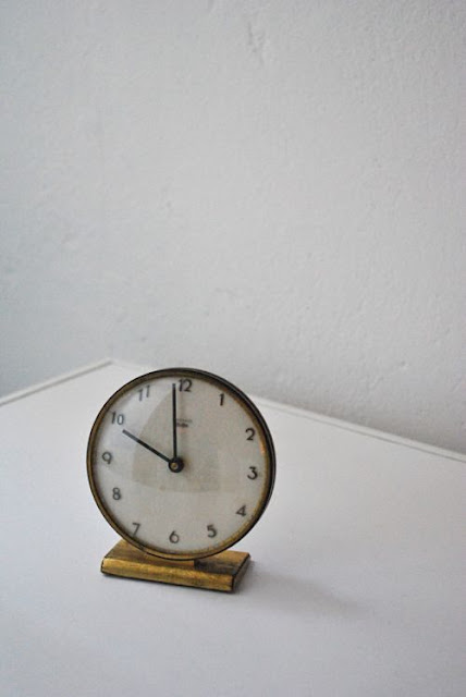 Vintage brass clock with white face - found on Hello Lovely Studio