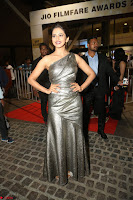 Rakul Preet Singh in Shining Glittering Golden Half Shoulder Gown at 64th Jio Filmfare Awards South ~  Exclusive 049.JPG