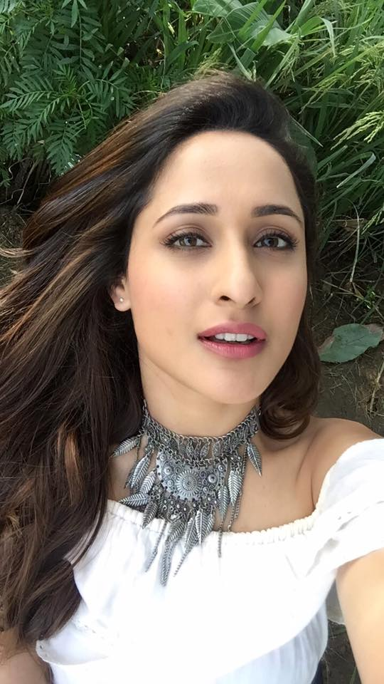 Telugu Actress Pragya Jaiswal Long Hair Face Closeup Stills