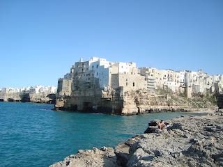 Polignano a Mare, where Modugno was born, is built on rocky promontories overlooking the Adriatic sea
