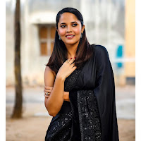 Anchor Anasuya Glam Stills in Black Saree TollywoodBlog