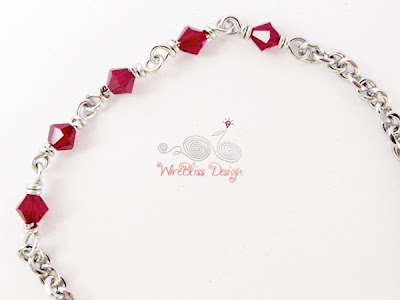 Closeup of Wire Wrapped Minlet (Minima Bracelet) with 4mm Ruby Swarovski crystal