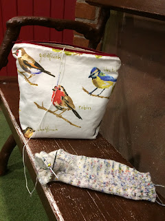 Bird project bag and sock being knitted