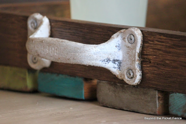 Metal handles painted with chalk paint on a wood tray