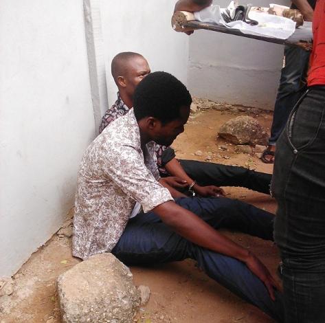 seun egbegbe in handcuffs