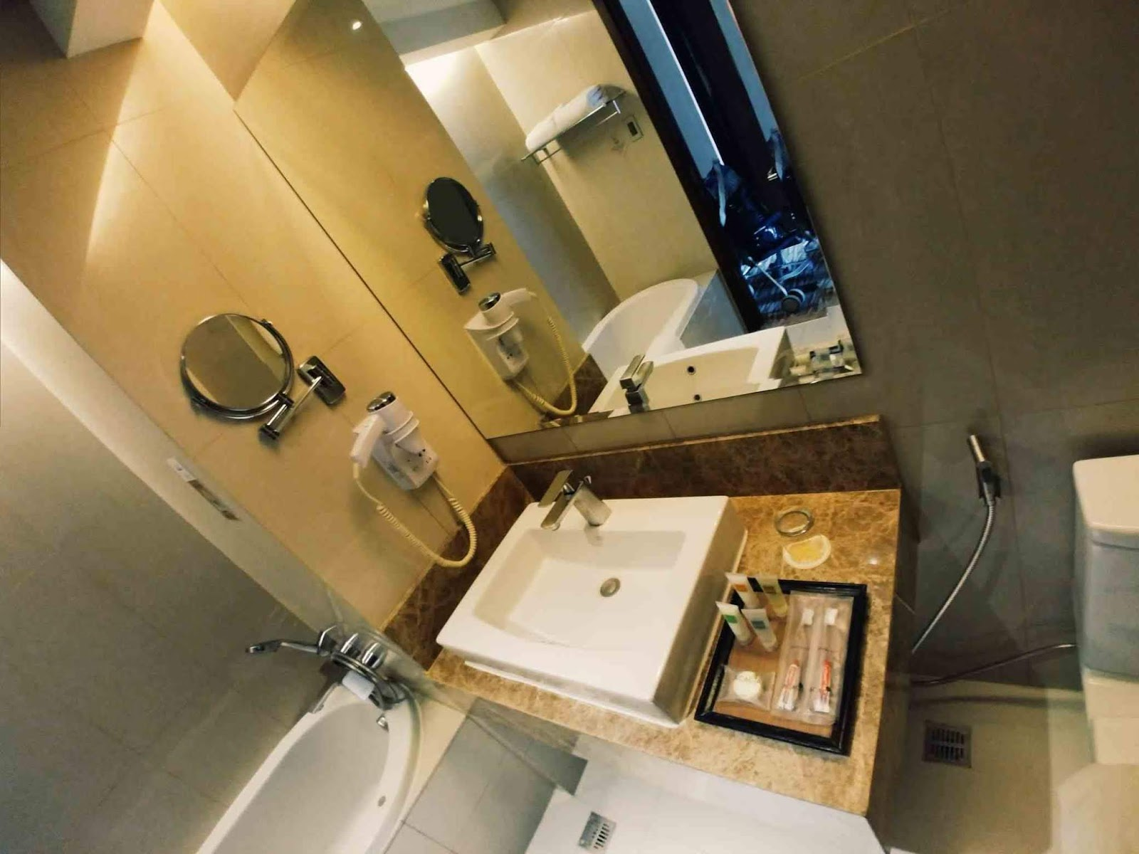 bathroom sink at Acacia Hotel
