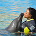 Actress Ini Edo Pictured Kissing a Dolphin at AquaVenture Atlantis Resort. Dubai