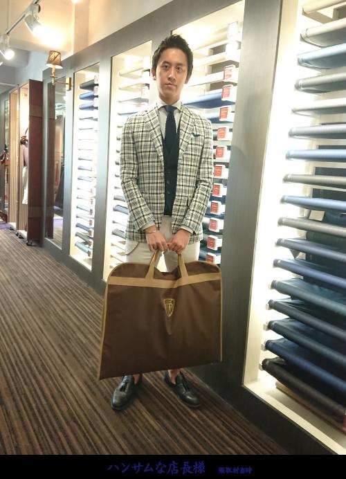 ハンサムな店長と持ち運び形式のガーメントバッグ