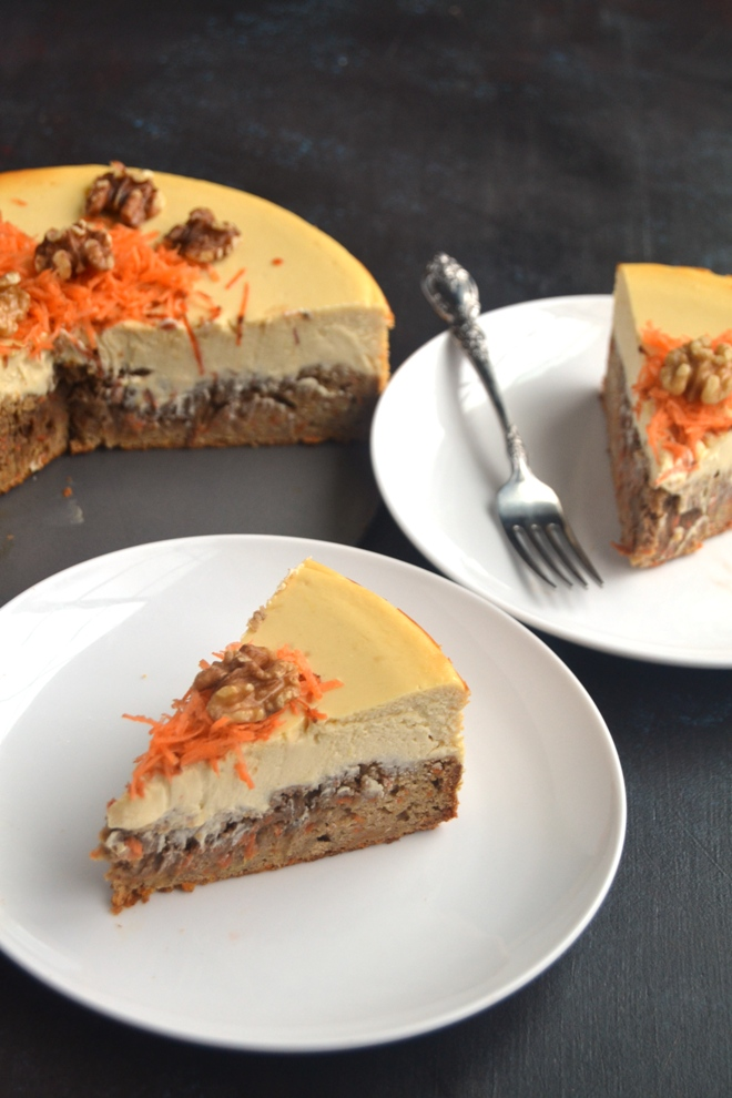 Carrot Cake Cheesecake features a whole-grain, dense carrot cake bottom and rich, creamy, Greek yogurt cheesecake combined in one for the perfect dessert! www.nutritionistreviews.com