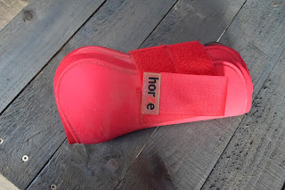 One red tendon boot for horses