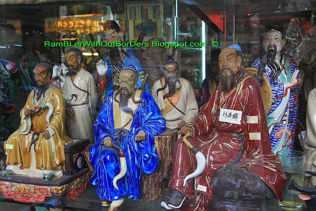 Shop windows showing figurines of Chinese pantheon, Shanghai Street, Yau Ma Tei, Hong Kong