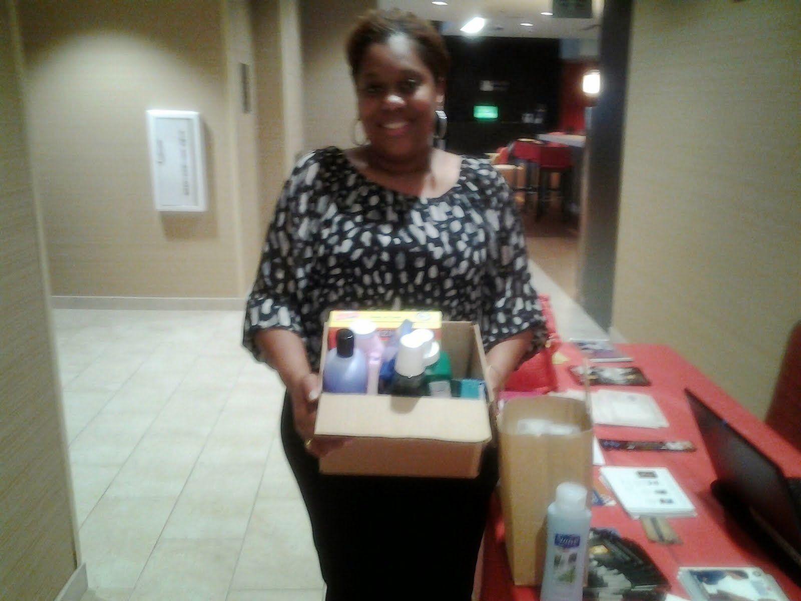 A Shelter Director picking up donated goods from a 2014 CAOT Christian book tour stop!