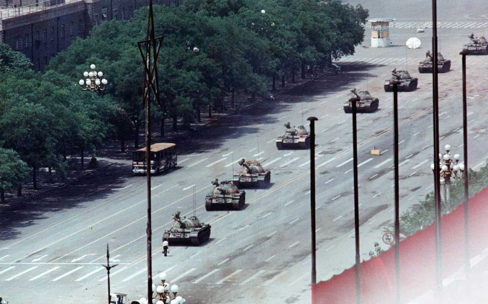 2 of 2) A citizen stands passively in front of Chinese tanks in this June 5, 1989, photo taken during the crushing of the Tiananmen Square uprising.