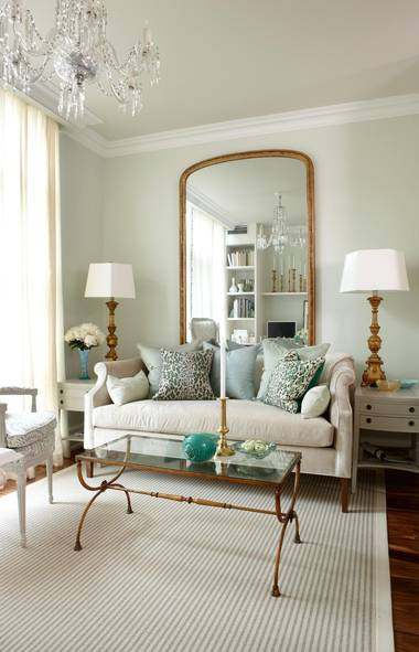 Vintage I couldn ut imagine that personally then I went on pinterest and found several living rooms that had a huge mirror turned vertical behind the sofa