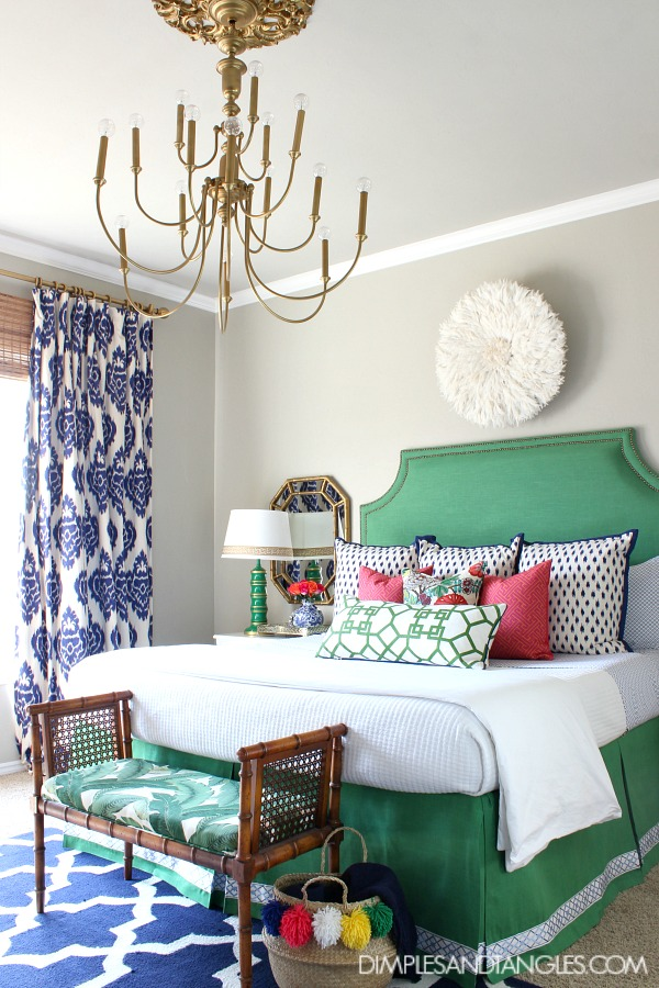 green upholstered headboard, blue ikat kalah curtains, bamboo bench, brass chandelier, bedroom styling, bamboo mirror, juju hat, chiang mai dragon, xu garden pillow