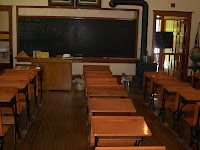 Museum Photo of wooden benches and blackboard