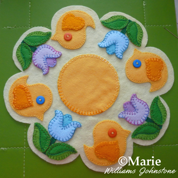 Yellow chick birds and tulip flowers for a Spring and Easter themed felt applique mat pattern for the table