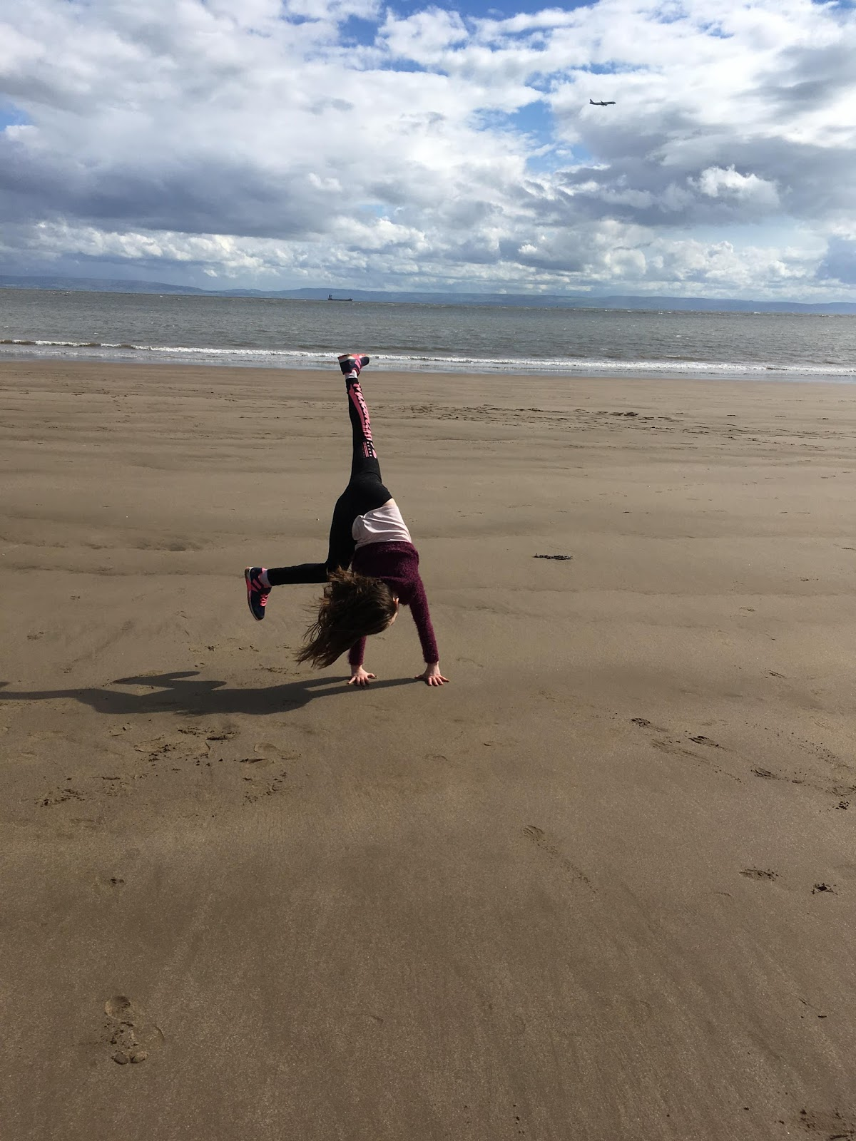 Caitlin cartwheeling on Barry Island Beach - the importance of outdoor play