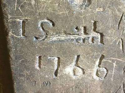 Stone with carved graffiti  reading 'J Smith 1766'