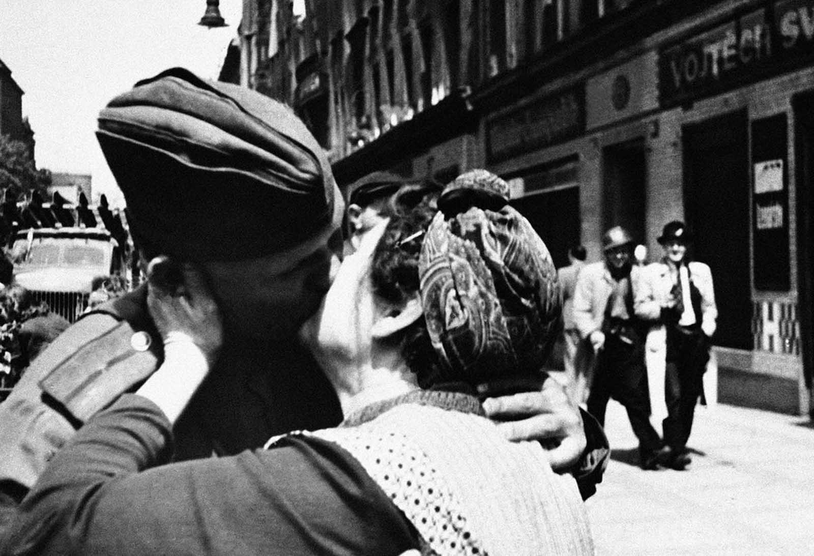 Overwhelmed with emotion, this Czech mother kisses a Russian soldier in Prague, Czech Republic on May 5, 1945, thanking one who fought to free her beloved home.