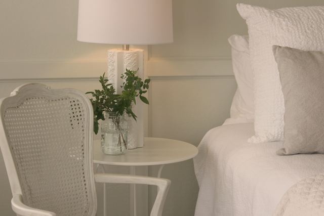 Simple minimal French farmhouse style all white bedroom by Hello Lovely Studio