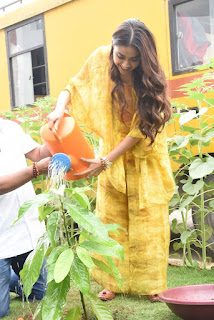 Keerthy Suresh in Yellow Dress with Cute and Awesome Lovely Smile While Planting a Plant 3