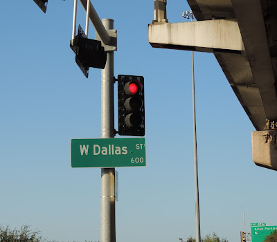 W Dallas Street with traffic light (red)