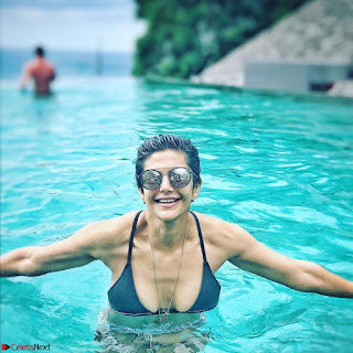 Mandira Bedi Celetes New Year 2018 in Bikini pool side Exclusive Gallery