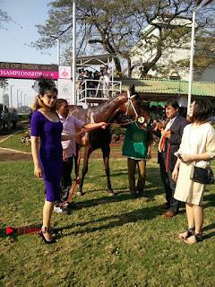 Bollywood Actress Kangana Ranaut Stills in Purple Short Dress at the Derby  0004.jpg