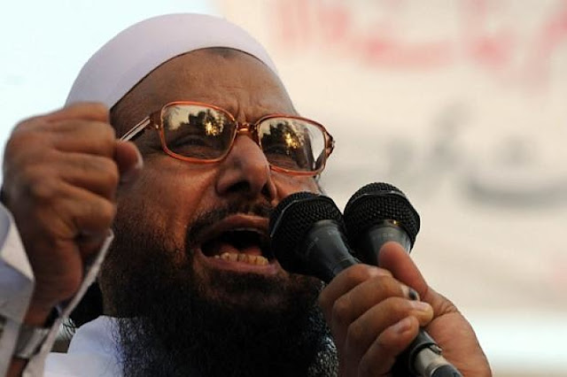 Image Attribute: Hafiz Saeed, co-founder of Lashkar-e-Taiba and the chief or amir of Jama'at-ud-Da'wah, / Source: The UnReal Times