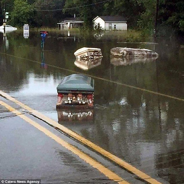 5 dead, coffins from graves float on water as flood override Louisiana