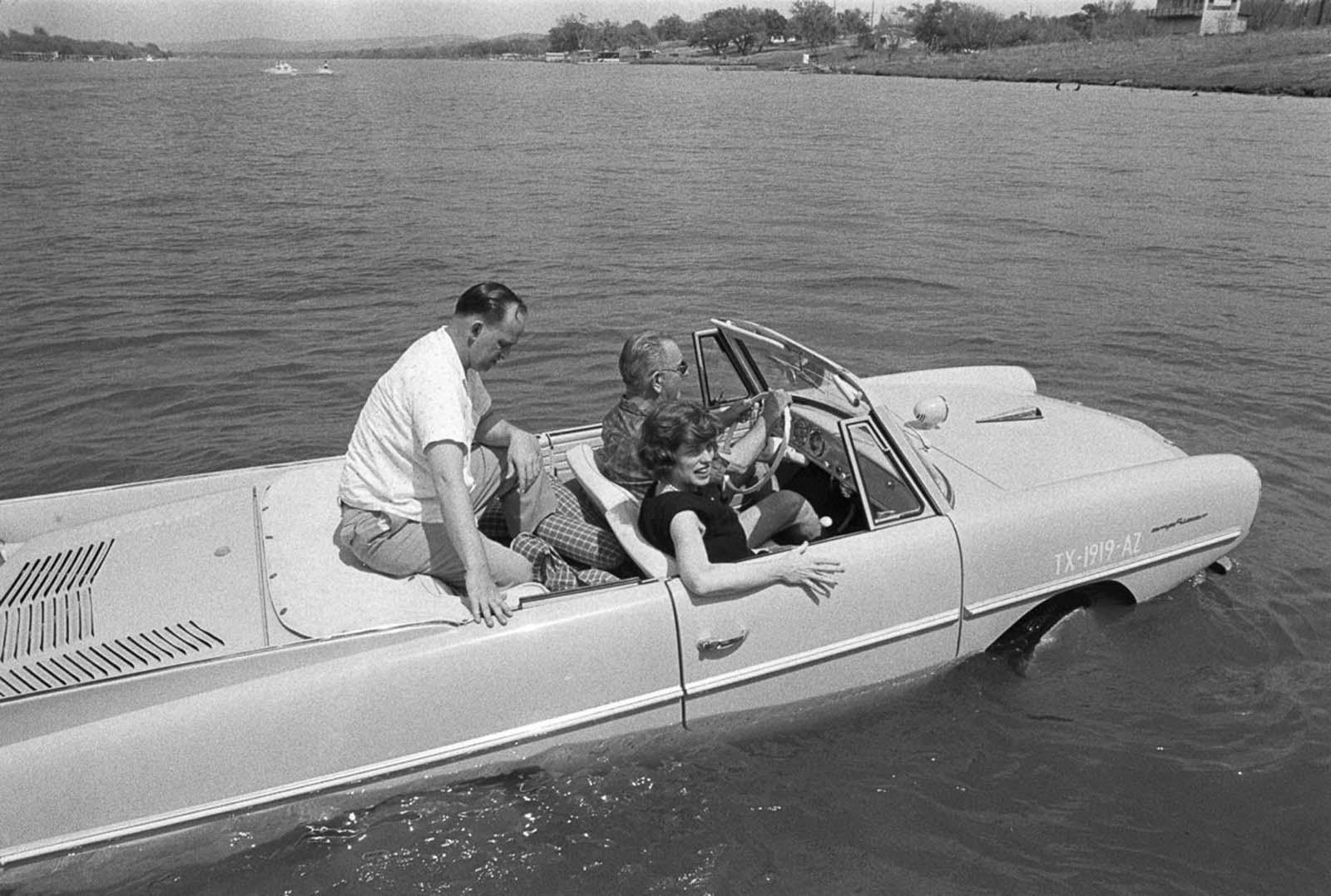 President Lyndon Johnson drives an Amphicar at his Texas ranch. 1965.