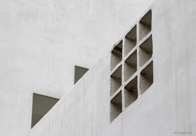 A looking-up Minimal Art Photograph of 10 Squares and 2 Triangles shot at Jawahar Kala Kendra, Jaipur