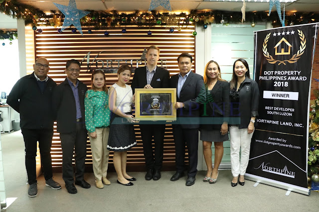 Representatives from Dot Property Awards namely: Tanya Yu & Cheyenne Hollis (center) with the NLI executives (left to right): Paul D. Lamagna (AVP for Technical Management Group), Benigno A. Tatunay (CFO), Wilhelmina E. Fernando (VP for Corporate Services), Ferdinand M. Macabanti (General Manager), Aileen B. Morales (AVP for Sales Operations), and Amytis S. Banaag (AVP for HRODA)