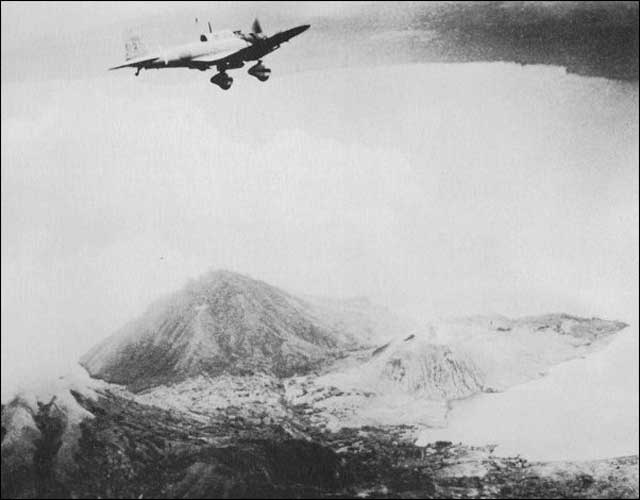 A Japanese dive-bomber over Rabaul on 20 January 1942 worldwartwo.filminspector.com