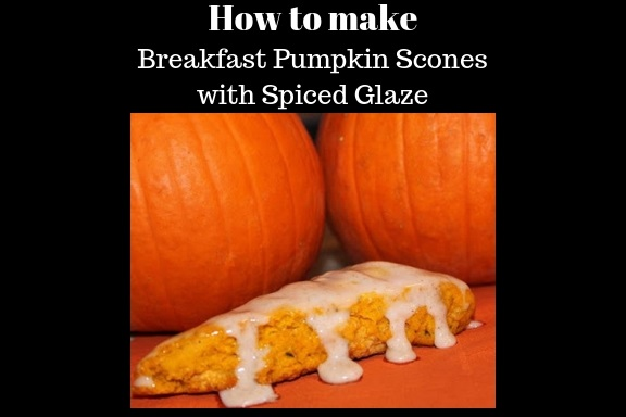 this is a recipe for how to make pumpkin scones from scratch with two sugar pie pumpkins in the background. These pumpkin scones have a spiced powdered sugar glaze on top.
