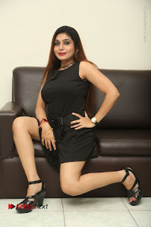 Tollywood Upcoming Actress Pooja Roshan Stills in Black Short Dress at Plus 1 Movie Trailer Launch  0289.JPG