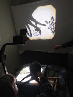 octopus puppet in shadow puppetry, putting wheelchair shadow puppet into the dark